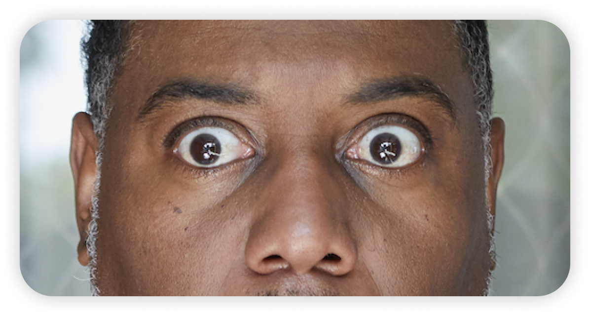 Man's shocked eyes close up